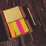 Post it notes and pen on wooden bench