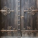 photo of door with ornate hinges