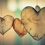 heart shaped slices of wood hanging from string