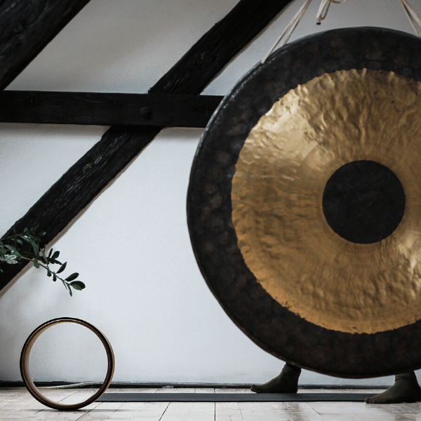 A brass gong on a white table.