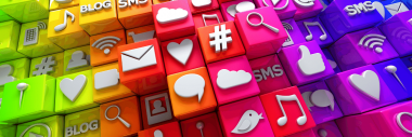 Image of small blocks stacked on top of each other. They are brightly coloured and have social media and other internet icons & symbols on top of them.