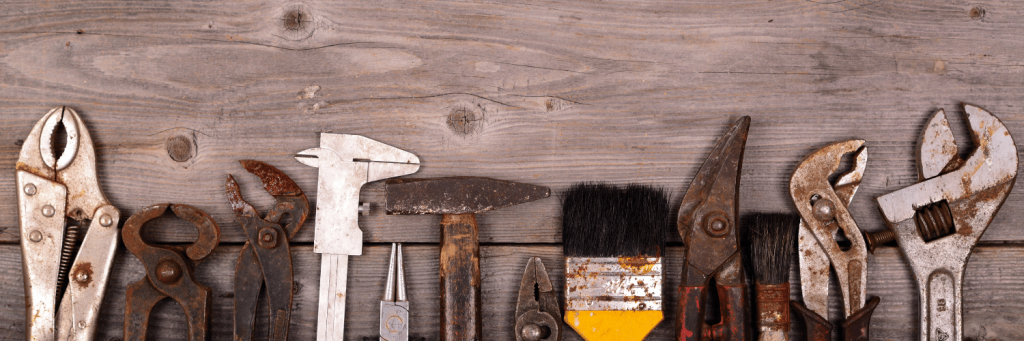 A wooden background with a series of tools.